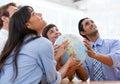 International business team holding a globe Royalty Free Stock Photo
