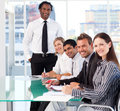 International business team smiling at the camera Royalty Free Stock Photo