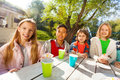 International children drink tea and eat cupcakes Royalty Free Stock Photo