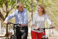 International family of active pensioners smiling couple with bikes Stock Photo