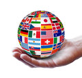 International global business concept travel services and with a globe and flags of the world on a man hand isolated on Stock Photos