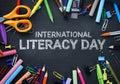 International Literacy Day. School Stationary Top View on Blackboard Royalty Free Stock Photo