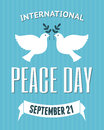 International peace day poster vintage for the of with a dove carrying an olive branch Royalty Free Stock Photos