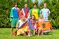 International sportsteam sports team with men and women from various nationalities each dressed in the color of their nation Royalty Free Stock Image