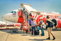 International tourist people boarding Airasia flight in Bangkok airport