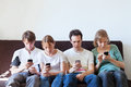 Internet addiction group of young people looking at their smart phones Stock Images