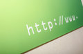 Internet address on green banne banner wall Royalty Free Stock Images