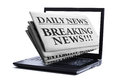 Internet breaking news newspaper through a laptop screen concept for latest online Royalty Free Stock Image
