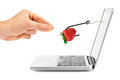 Internet fraud concept. hook with bait through laptop screen Royalty Free Stock Photo