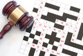 Internet laws crossword with issues relating to the and a gavel on one side Stock Image