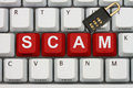 Internet scam computer keyboard keys with word and lock Stock Photo