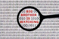 Internet security concept the words big brother is watching on a digital tablet screen with a magnifying glass Royalty Free Stock Photography