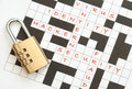 Internet security padlock on a crossword with terms relating to Stock Photography