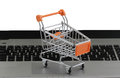 Internet shopping on the laptop cart Royalty Free Stock Images