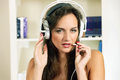 Internet telephony young woman in private call with headset Royalty Free Stock Image