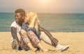 Interracial couple on the beach Royalty Free Stock Image