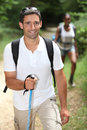 Interracial couple hiking forest Stock Photos