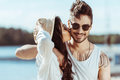 Interracial couple in sunglasses hugging while girl kissing her boyfriend Royalty Free Stock Photo