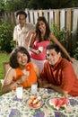 Interracial family in backyard Royalty Free Stock Photo