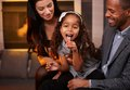 Interracial family having fun at home smiling Stock Image
