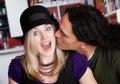 Interracial kiss alone at a cafe Royalty Free Stock Photo