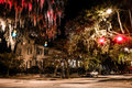 Intersection of Drayton and Gaston Streets at night in Savannah, Georgia.