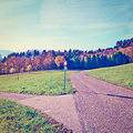 Intersection of rural roads leading to the farmhouses in the swiss alps instagram effect Stock Photography
