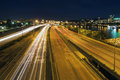 Interstate freeway light trails through portland oregon city along willamette river at night Royalty Free Stock Image