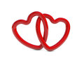 Intertwined red heart rings Stock Photography