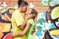 Intimacy image of young couple embracing on background of graffiti wall Stock Photos