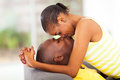 Intimate african couple young american kissing and flirting Royalty Free Stock Photography