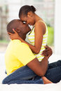 Intimate couple kissing cute young african american in bed Royalty Free Stock Photo