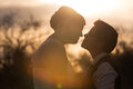 Intimate lesbian couple bright sunset behind outdoors Royalty Free Stock Photo