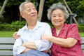 An intimate senior couple embraced Stock Photography