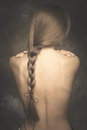 Intimate woman portrait bare back and long braid Royalty Free Stock Photo