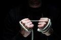 Intimidation criminal hands holding a rope Royalty Free Stock Photo