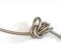 Intricate Metal Hose Knot