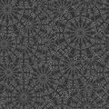 Intricate seamless floral pattern. Repeating gray background with overlapping stylized flowers. Hand drawn pattern. Vector Royalty Free Stock Photo