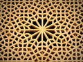 Intricate wooden window with self sustained geometric pattern design patterns on the windows of ali qappu palace of isfahan using Stock Photography