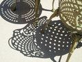Intriguing shadows decorative iron chair and table yield interesting Royalty Free Stock Photography