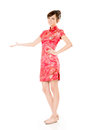 Introduce smiling chinese woman dress traditional cheongsam and on white background Royalty Free Stock Images