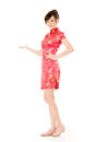 Introduce smiling chinese woman dress traditional cheongsam and on white background Royalty Free Stock Photos