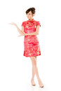 Introduce smiling chinese woman dress traditional cheongsam and on white background Stock Photos