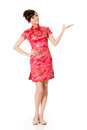 Introduce smiling chinese woman dress traditional cheongsam and on white background Royalty Free Stock Image