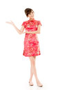 Introduce smiling chinese woman dress traditional cheongsam and on white background Stock Photo
