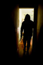 Intruder with knife an man a in silhouette Royalty Free Stock Images