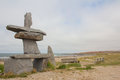 Inukshuk at the beach first nations shores of churchill manitoba canada Royalty Free Stock Images