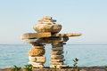 Inukshuk an on a shore of lake huron bruce peninsula ontario canada Royalty Free Stock Photo