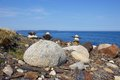 Inukshuks on rocky nova scotia canada coastline an inukshuk or inuksuk also known as an inunnguaq when it takes the form of a Stock Image