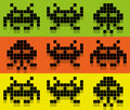 Invaders style pix colored pattern space invaders bit aliens set icons on background green orange yellow Royalty Free Stock Photo
